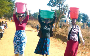 Wow! Bill gates wife visits malawi, carries water on her head