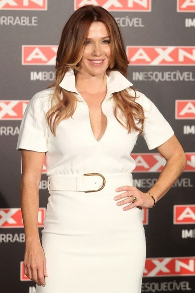 Poppy Montgomery Long Center Part Hairstyle