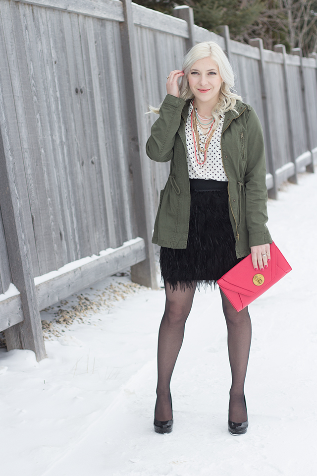 Jennifer Ashley wearing a feather skirt with a green army jacket.