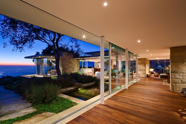 Home Night View with Green Garden and Wooden Interior Floor under White Ceiling