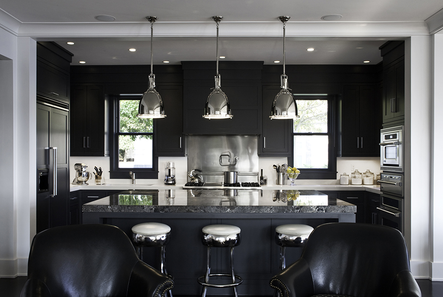 Small black kitchen with stainless and silver accents