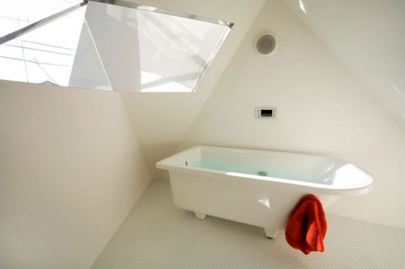 Japan home design small japanese house design in tokyo by for Small bathroom design in japan