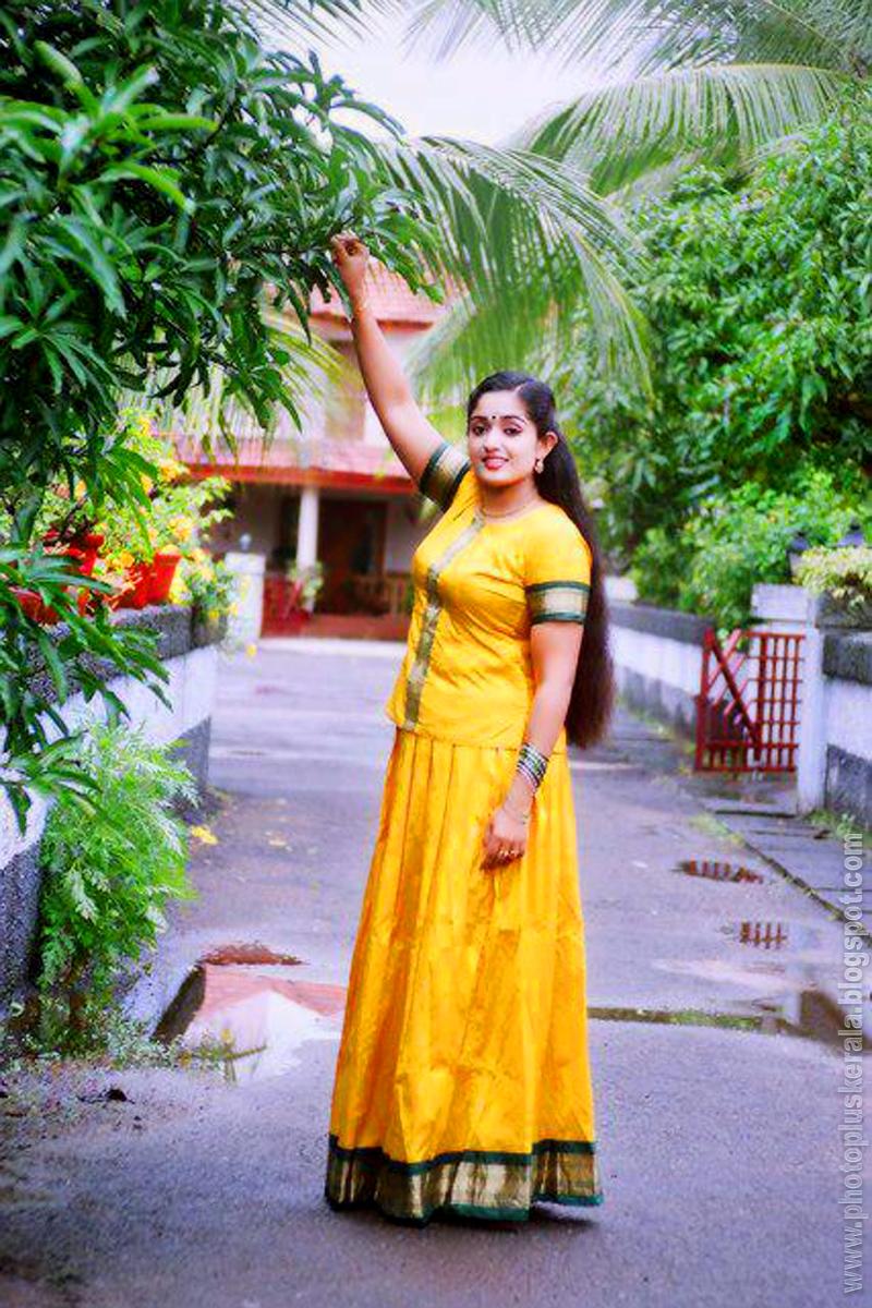 Kavya madhavan malayalam actress so cute in yellow lond skirt and long