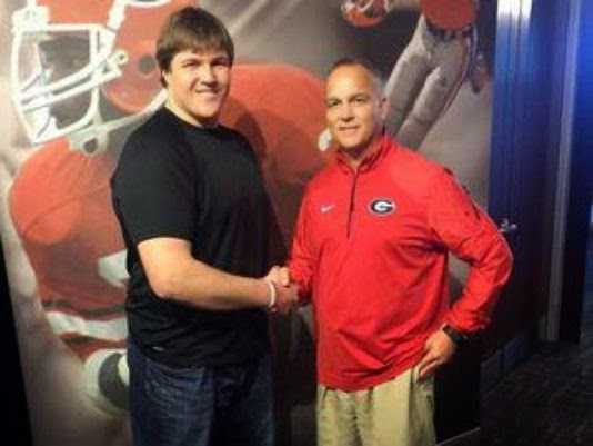 Mark Richt uses Krispy Kreme to help win commitment of four-star OL prospect.