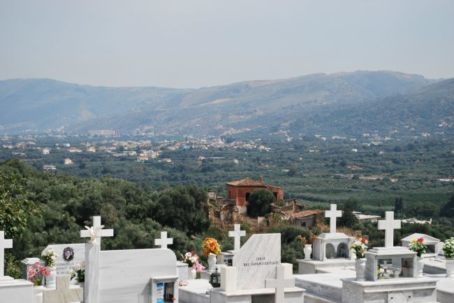 view from the cemetery with graves in foreground and Galatas beyond