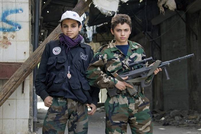 Issa is just one of many young fighters of the Syrian revolution….