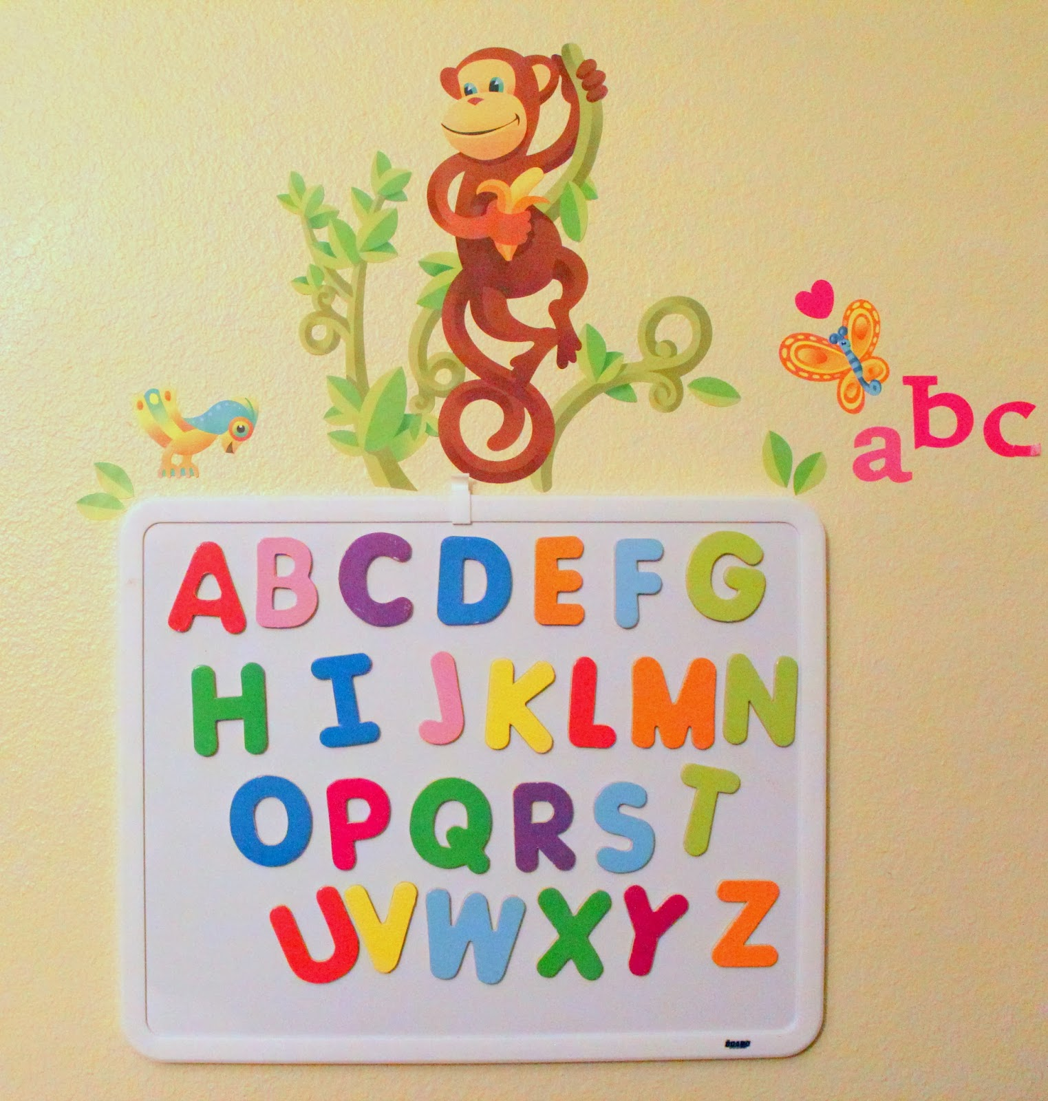 Learn the alphabet with a magnetic board and decorate the wall with removable wall decals