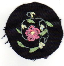 Flower is pink 4mm silk ribbon with lazy daisy stitch