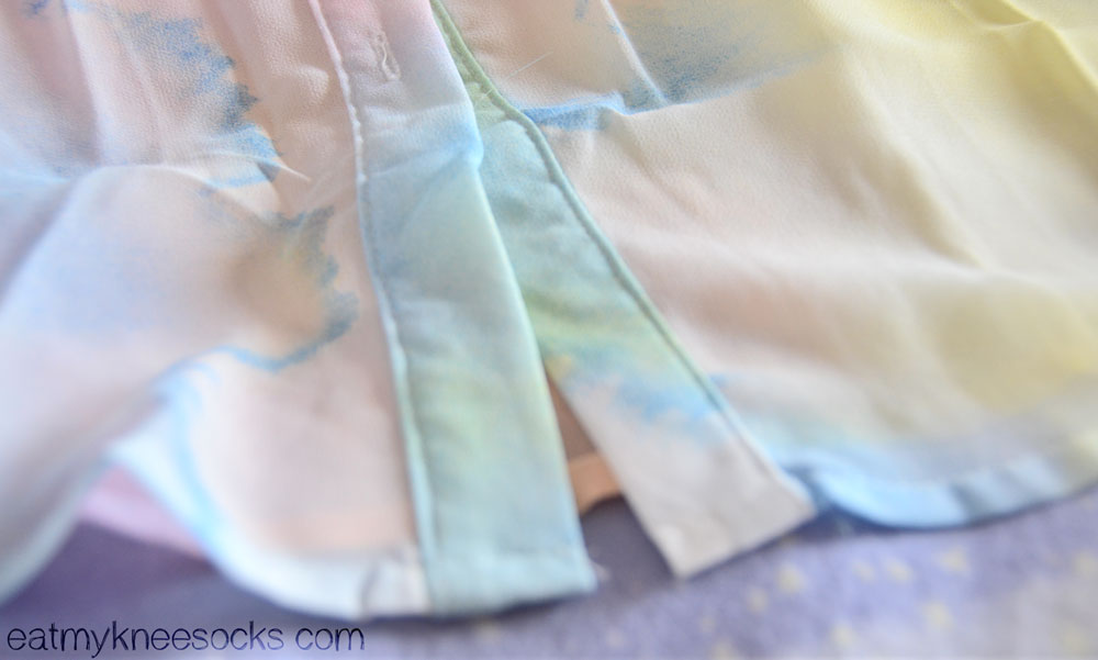 Close-up of the abstract printed hem on the pastel watercolor shirt from Romwe.