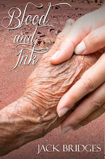 Image of a young person's hand holding an older person's tattooed hand