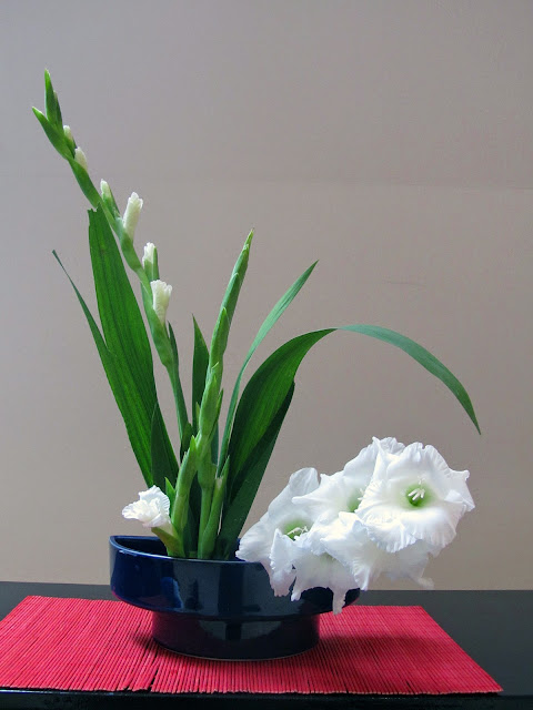 my first Kado arrangement with white gladioli