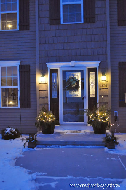 Winter Front Porch with lights - the colored door
