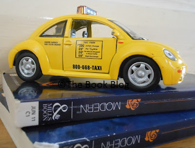 I-heard-a-tale-about-Mills&Boon-books-being-pulped-and-used-in-road-construction.-I-thought-this-photo-of-a-toy-yellow-cab-on-top-of-a-pile-of-Mills-&-Boon-books-illustrated-it-nicely-in-a-tongue-in-cheek-way.