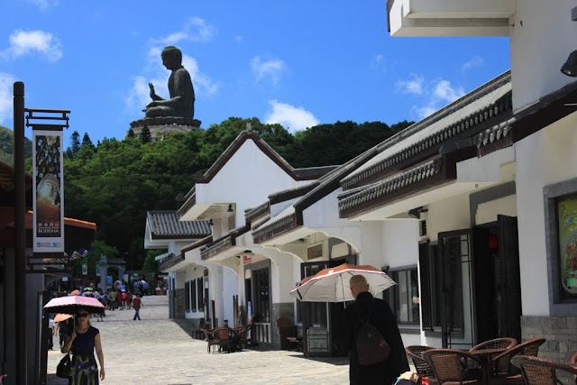 Walking towards to The Big Buddha Statue (Tian Tan Buddha) at Ngong Ping Village in Hong Kong