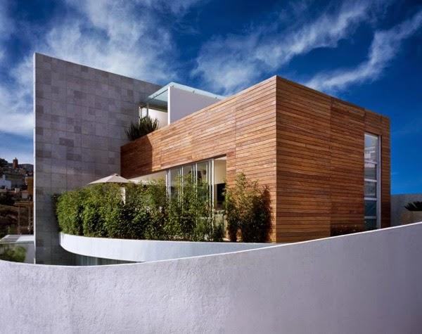 UNIQUE HOUSE ARCHITECTURAL DESIGN FEATURES A WARM YET