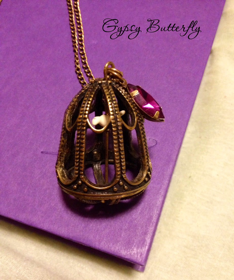 https://www.etsy.com/listing/196900512/birdcage-necklace-with-bird-inside?