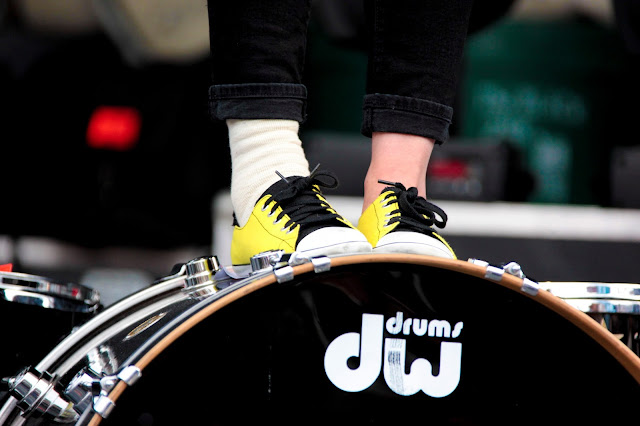 Kim's wrapped, injured ankle while she stands on her drum kit during a Matt & Kim show at Copper Mountain.