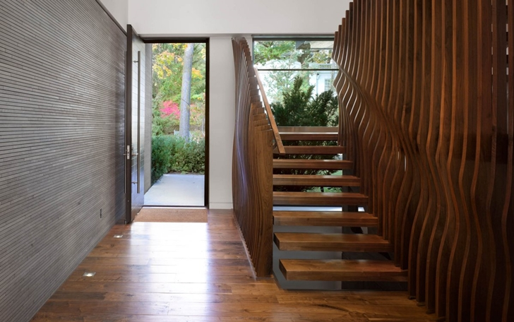 Entrance and stairs in Modern mansion by Belzberg Architects Group