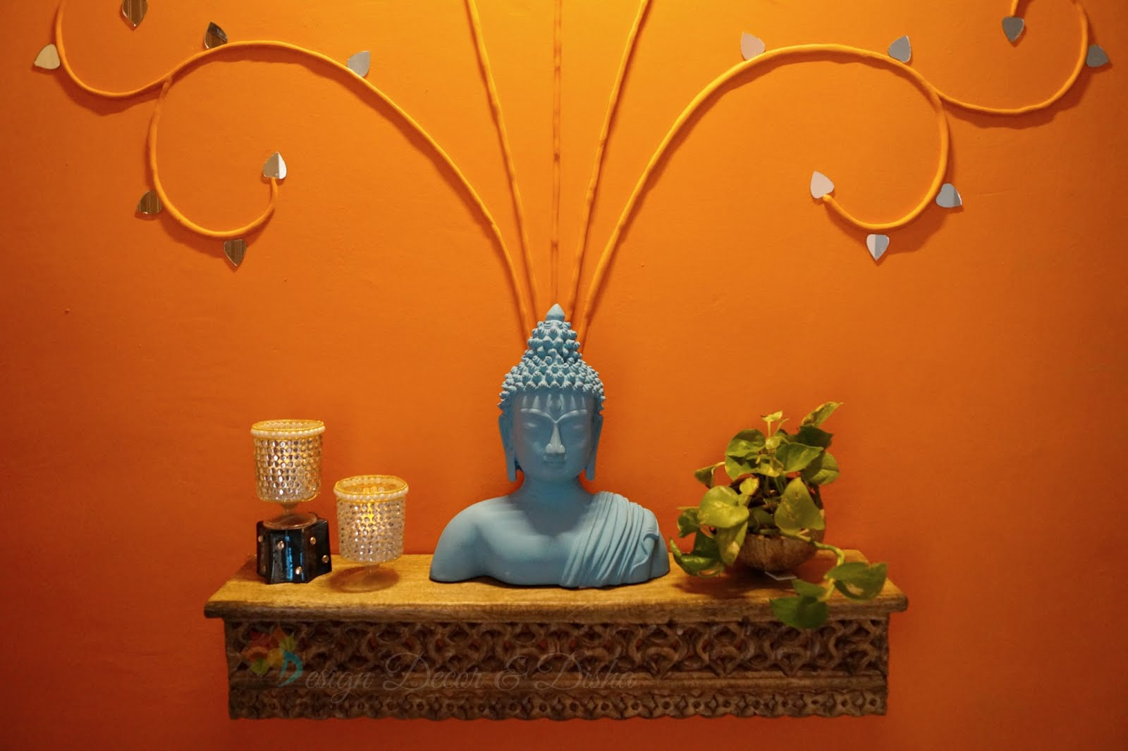Luxury Turquoise Buddha bust pops beautifully against glowing rust wall and greens just add the cheer here