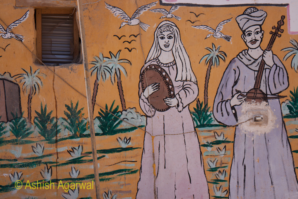 Painting of a man and a woman, on the wall of a small building near Luxor, in Egypt