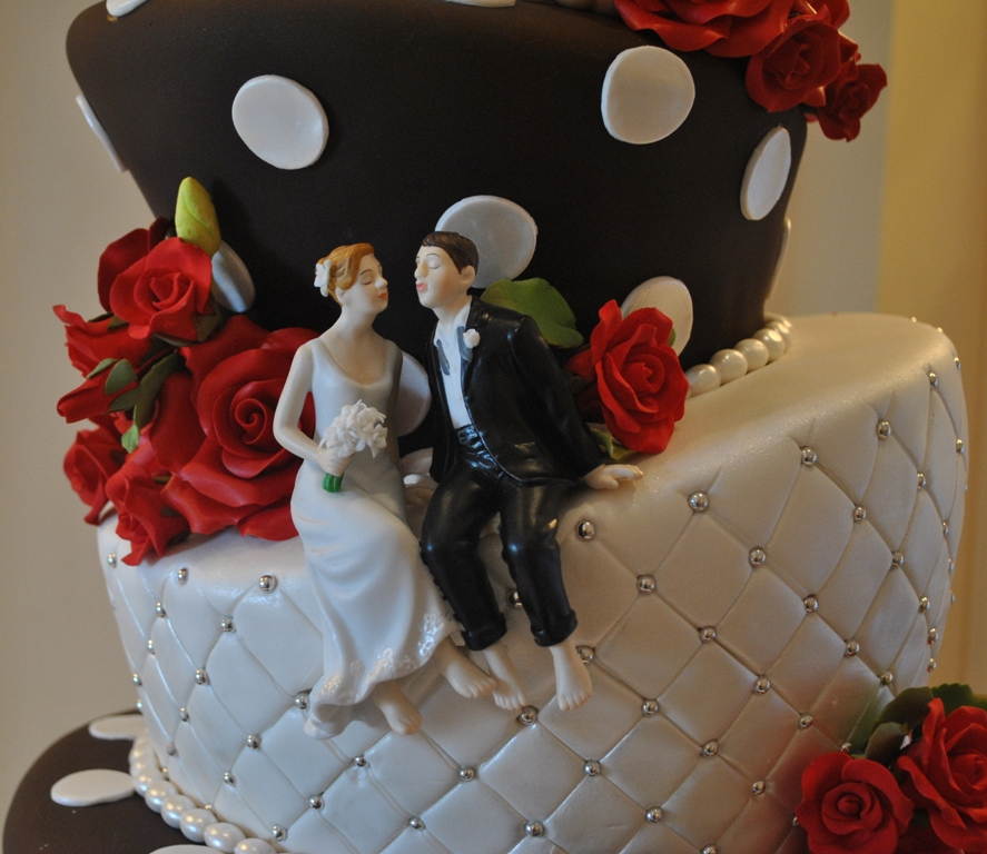 This 5tier black and white topsy turvy wedding cake is highlighted with red