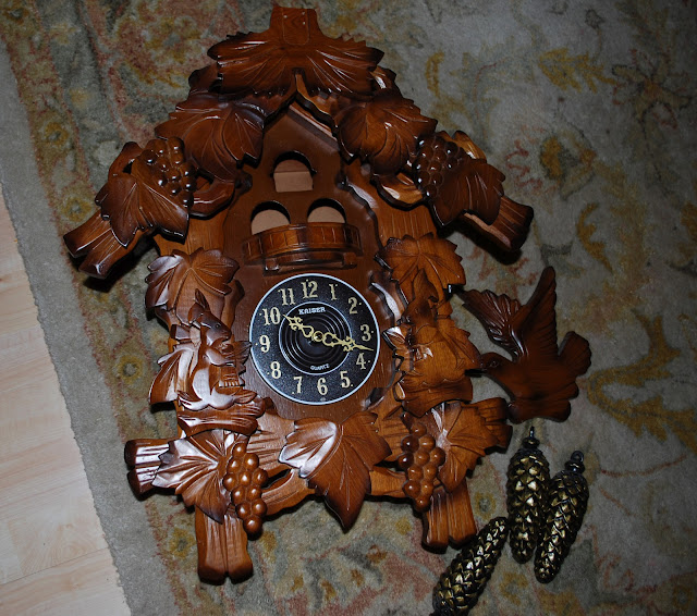 large brown cuckoo clock before painting it