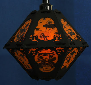 Black cats and mice fight in space on Halloween vintage-style lantern by Bindlegrim