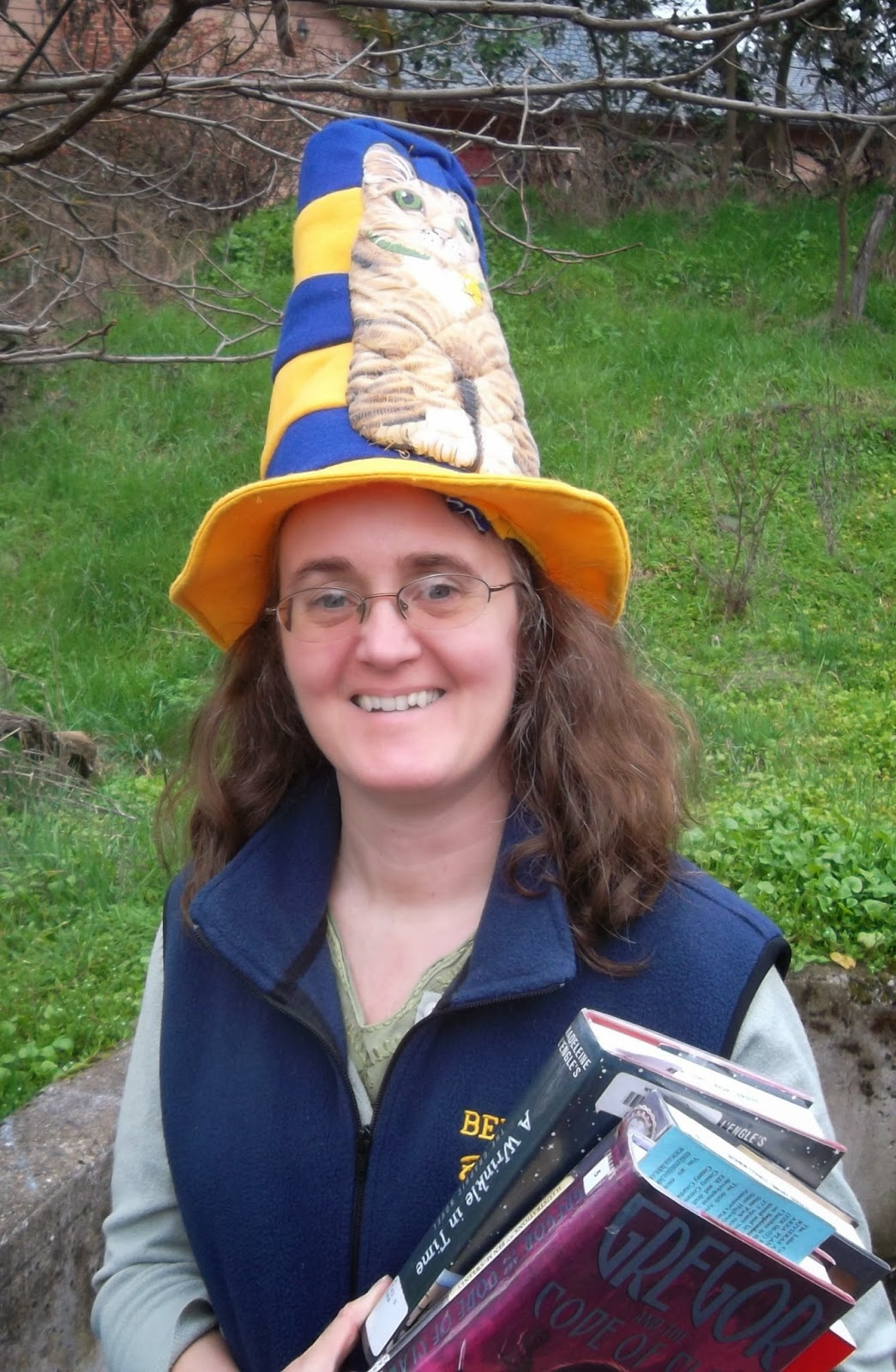 "Cynthia Parkhill wearing blue-and-gold ""Cat in the Hat"" hat with armload of books"