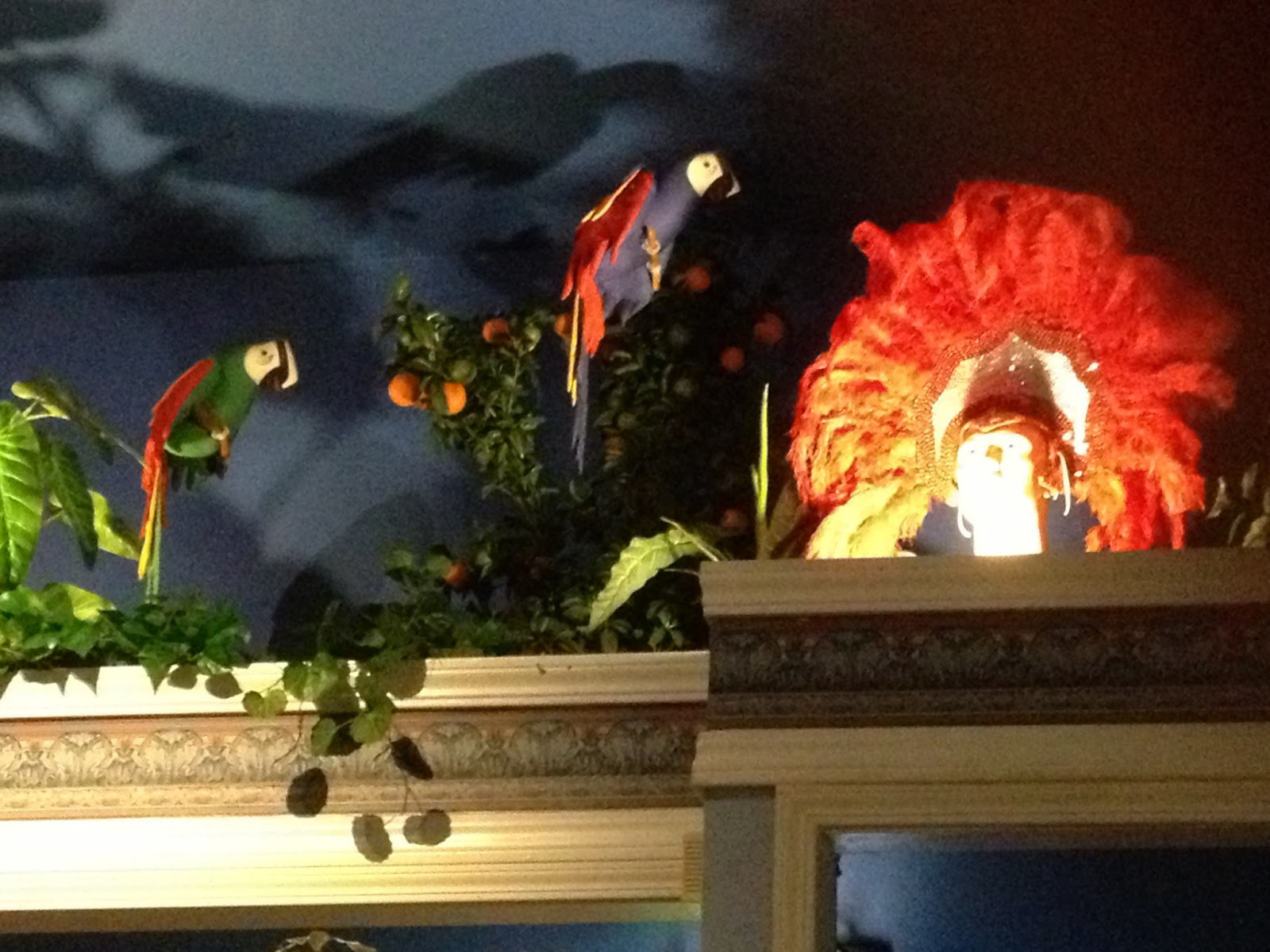 More restaurant decorations and ambiance: A couple parrots and a carnival headdress