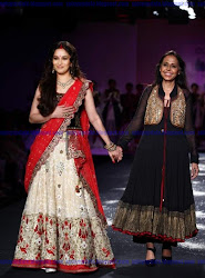 beautiful lehanga-choli, red dupatta, sindoor, Bollywood diva Madhuri Dixit, designer Anju Modi, Delhi Couture Week (DCW), ramp walk, gorgeous, achkans and saris