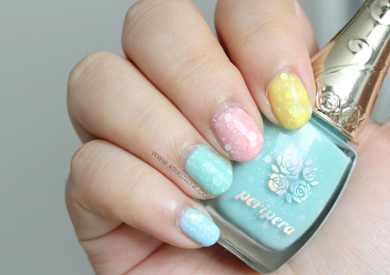 All four Peripera Sweet Meringue nail polishes on nails
