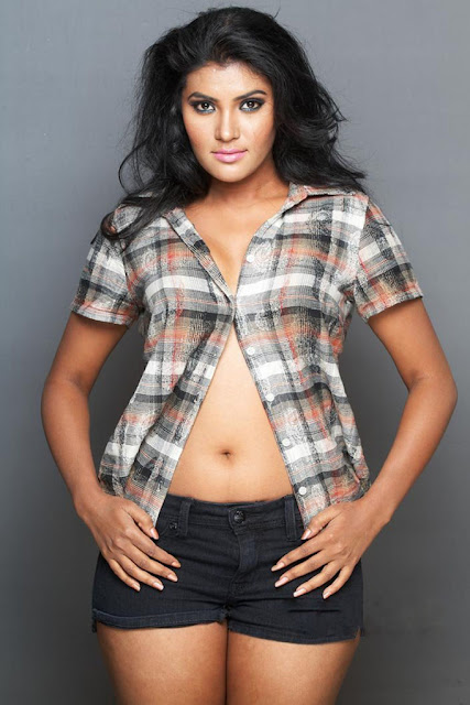 Actress Rhythamika Navel Show Photos
