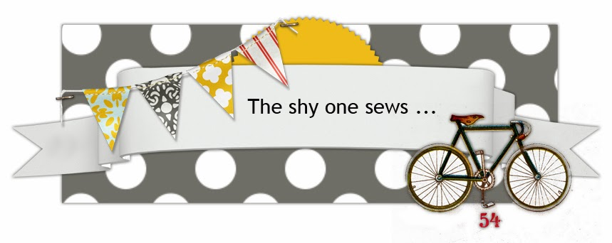 The shy one sews ...