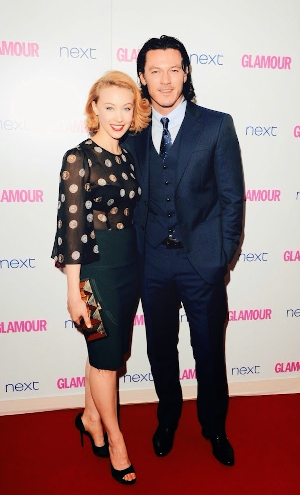 Sarah Gadon and Luke Evans in Giorgio Armani three piece navy suit at 2014 Glamour Women Of The Year Awards