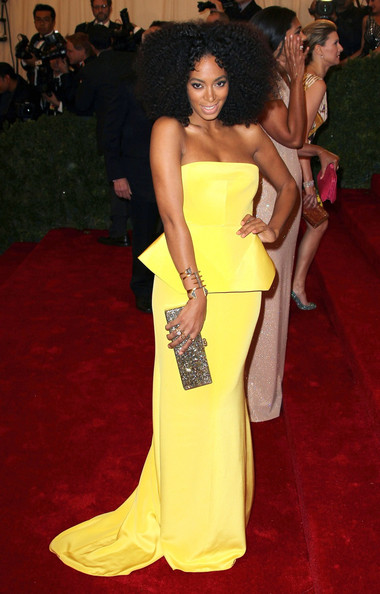 Solange Knowles in a bright, bold strapless canary yellow Rachel Roy peplum dress featuring a small tail at the Costume Institute Benefit Gala 2012 held at The Metropolitan Museum of Art on May 7, 2012 in New York City.