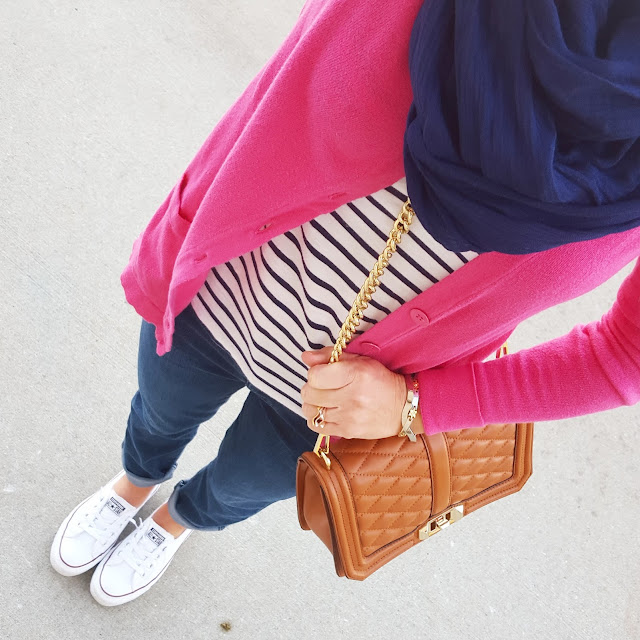 A bright pop of pink over a striped top