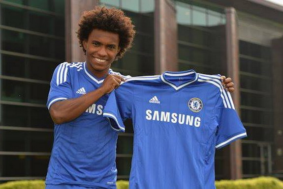 New signing Willian poses with his Chelsea jersey after completing his move from Anzhi