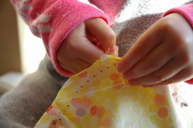 child sewing sunshine together