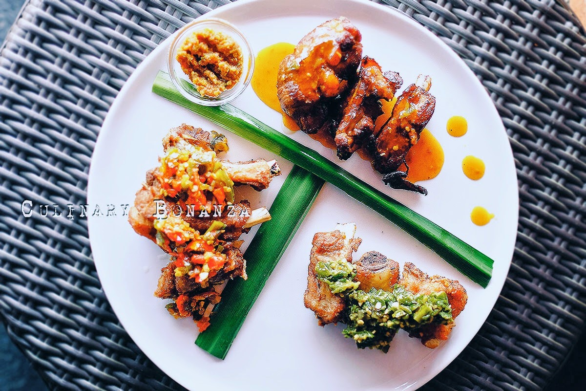 Iga Babi Tiga Rasa - pork ribs cooked and served in 3 different ways and sauces: Rica-Rica (sweet & spicy), Cabe Ijo (green chili) and Hitam Manis (sweet soy sauce)