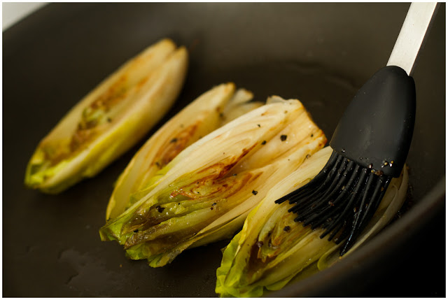 A photograph of Endives being seared and glazed