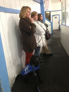 Coach, Jamie, Merideth and another mom watch the game from the goalie's perspective.