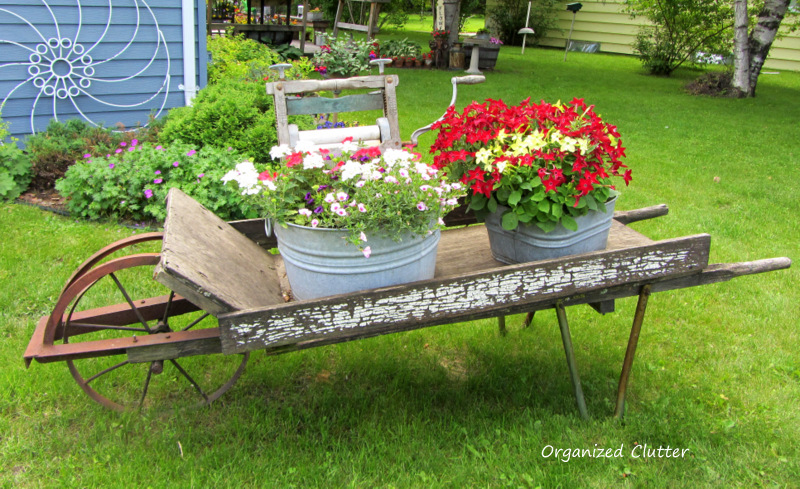 Weathered Wheelbarrow & Laundry Tub Planteres www.organizedclutterqueen.blogspot.com