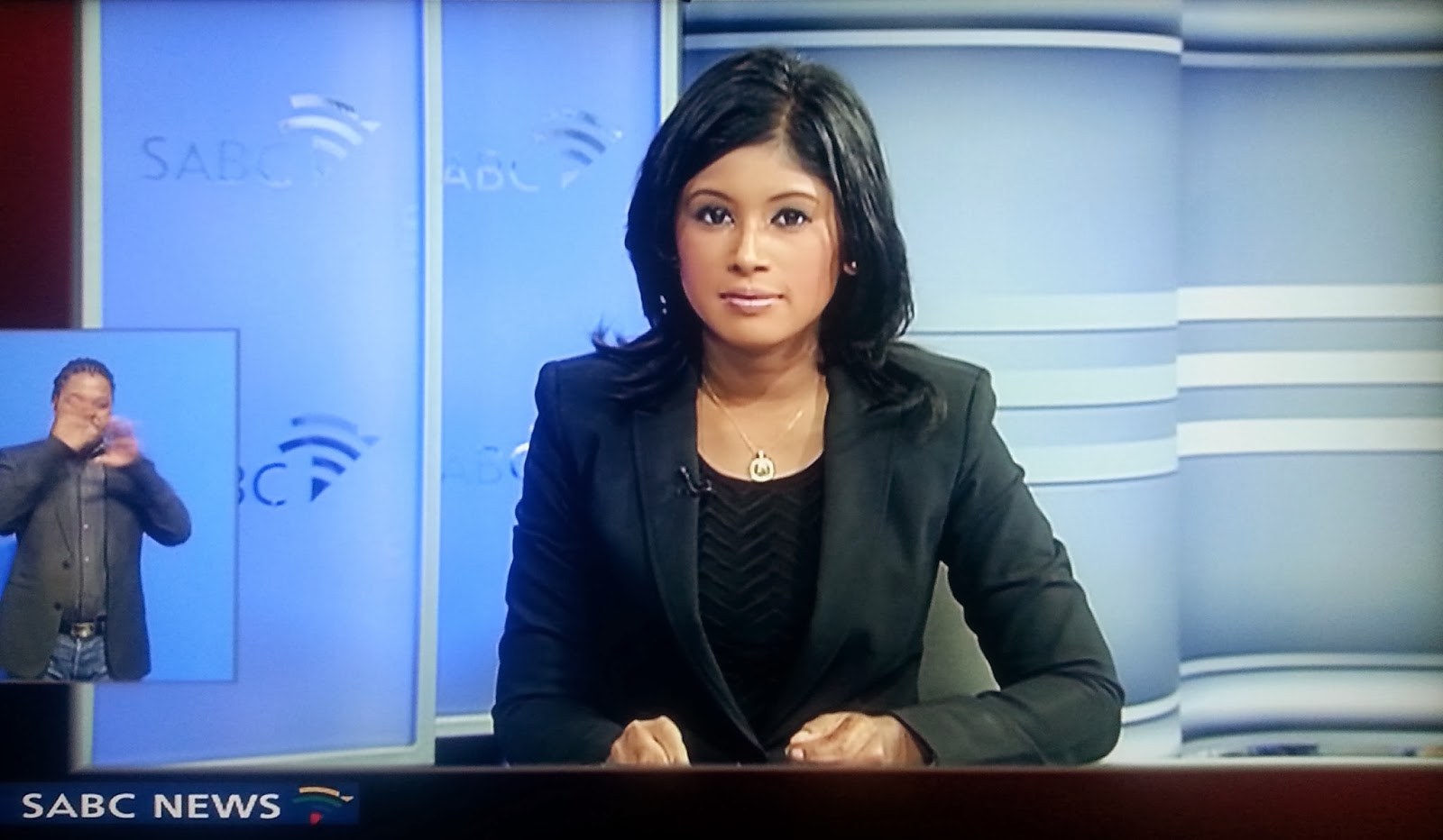 Female African News Reporter Working Outdoors Stock Photo