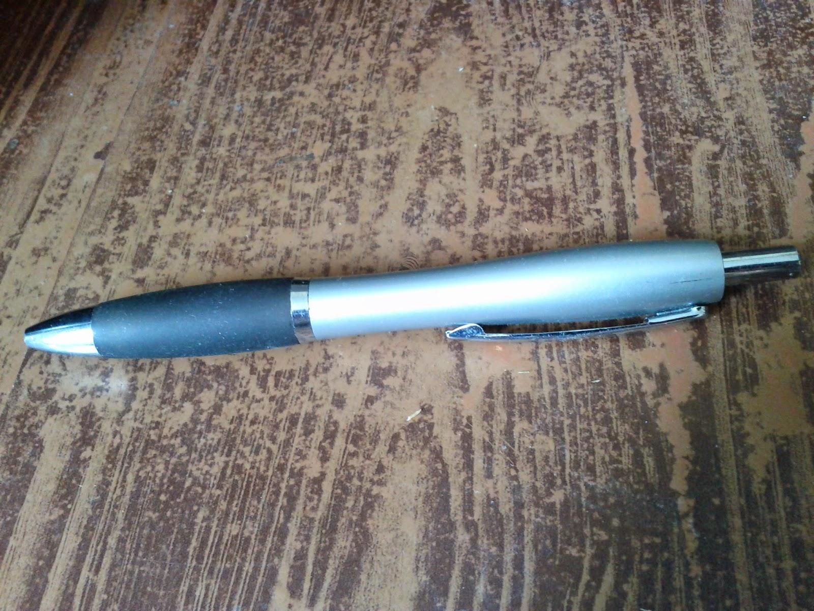 Pen (Silver on a wood desk)