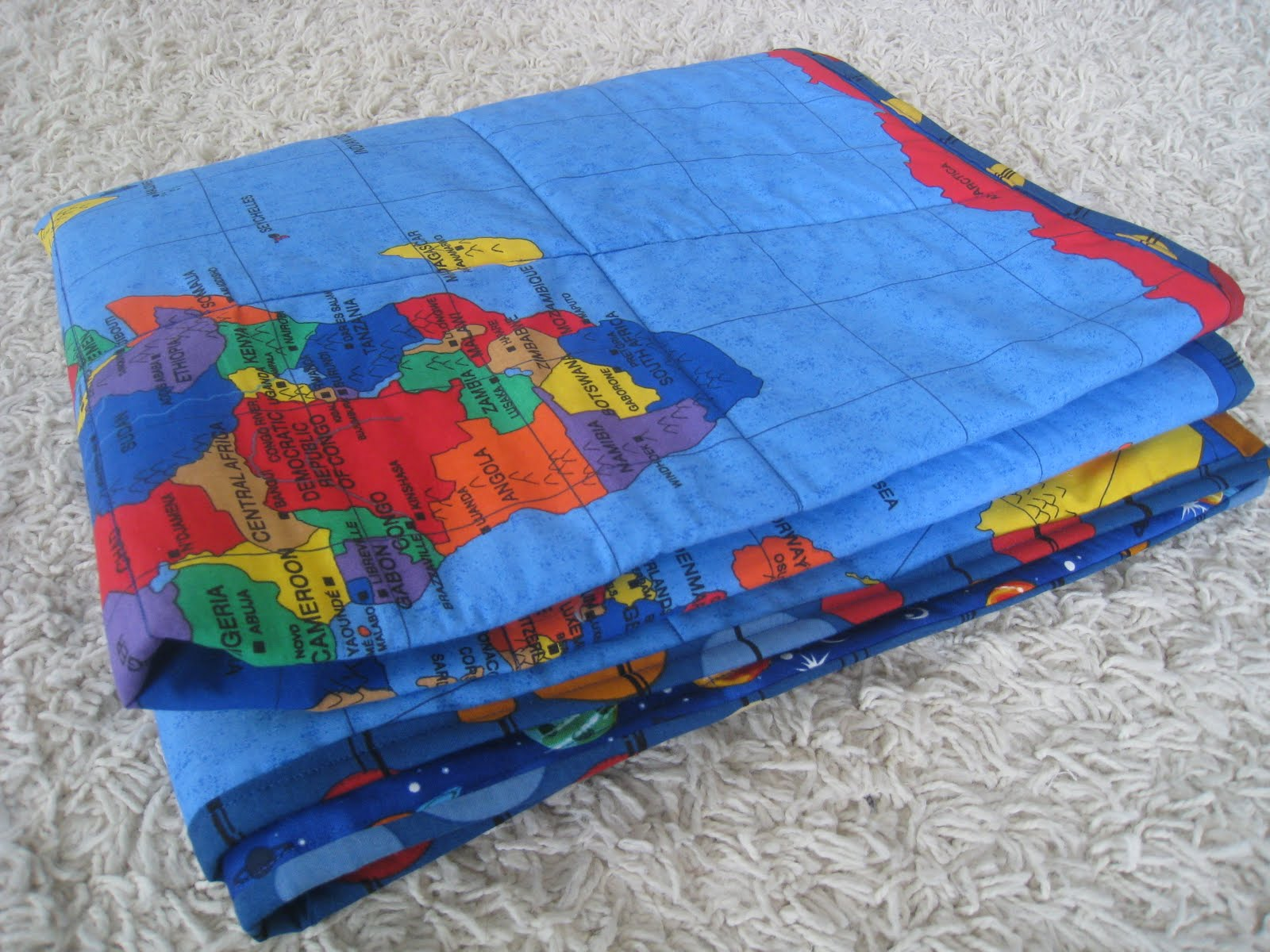All this for them kids map quilt because the usa side was slightly smaller than the world side i sewed some strips of space another big interest fabric onto the ends gumiabroncs Image collections