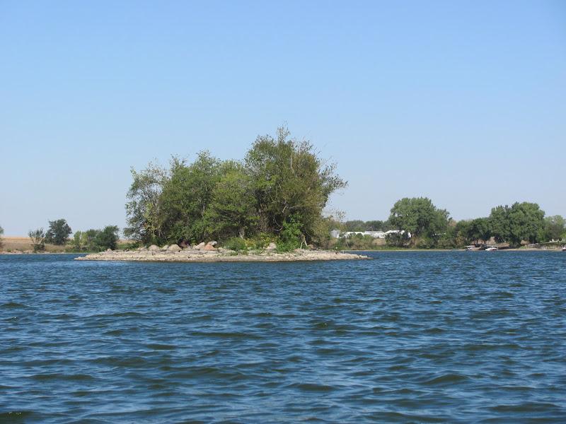 Kayaking the lakes of south dakota swan lake late summer for Public fishing access near me