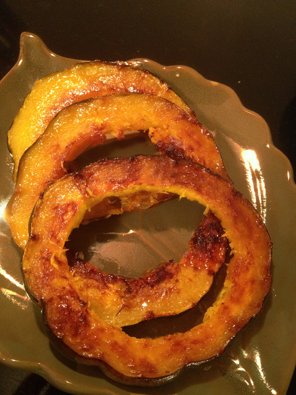 Honey-Ginger Glazed Acorn Squash on a green serving plate