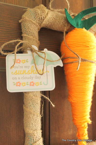 Carrot Spring Wreath -- grab some StyroFoam to make a fun carrot then add to a rectangular wreath.  A fun spring wreath that is cute and unique.