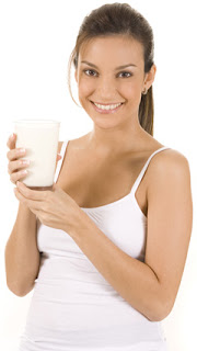 Young Woman Holding a Glass of Milk