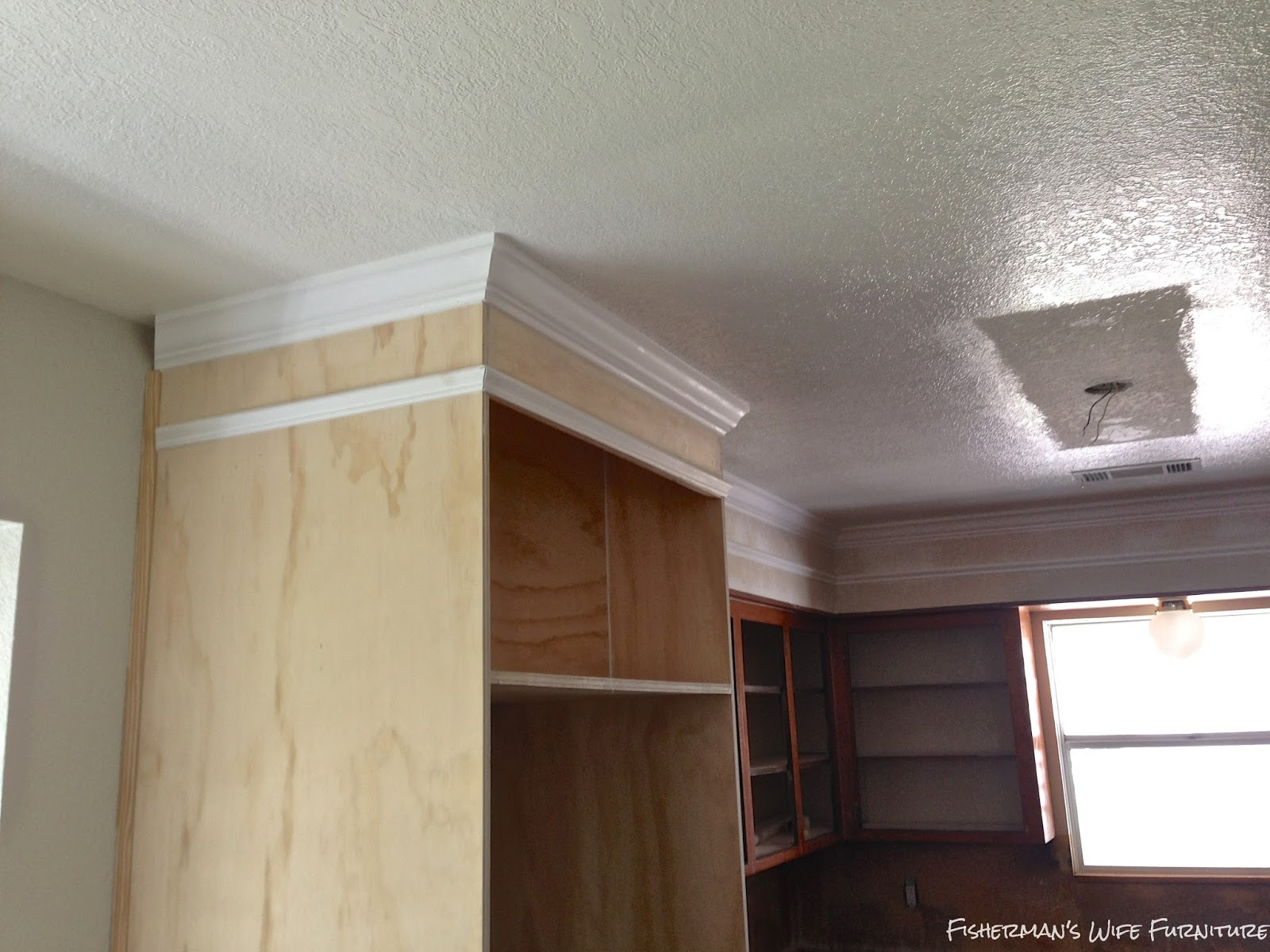 Fisherman 39 s wife furniture covering fur down the space for Bulkhead over kitchen cabinets